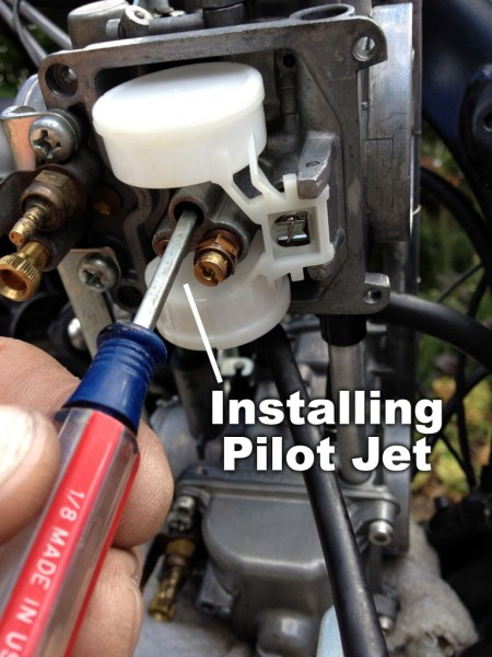 Installing the pilot jet with a small flat end screwdriver