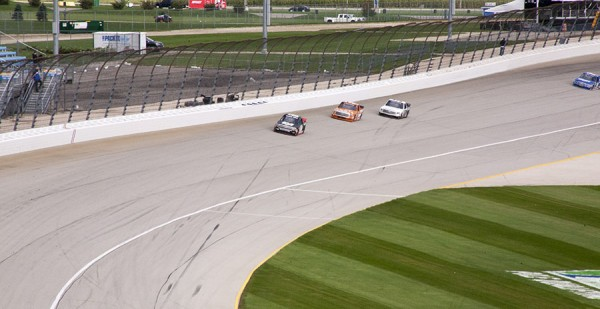 Kyle Larson in the #00 Chevy leading a pack around Turn 4.