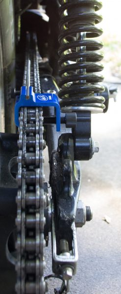 Aligning the chain, during a tension adjustment.