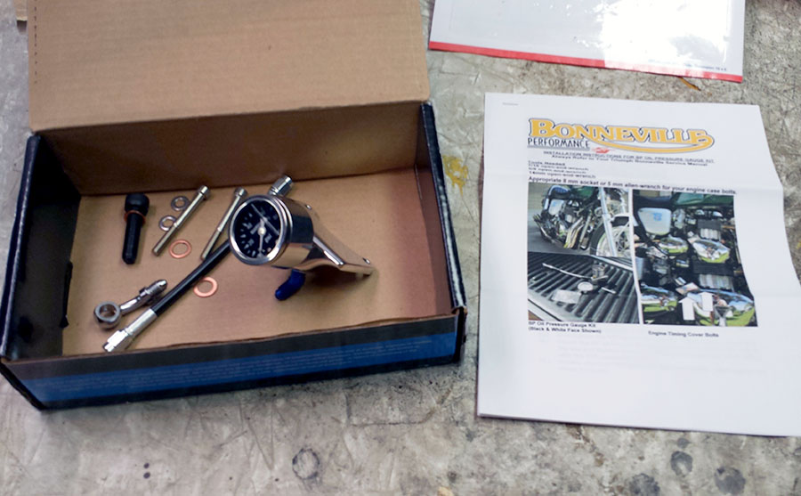 BP Oil Gauge Kit parts unwrapped, and installation instructions.